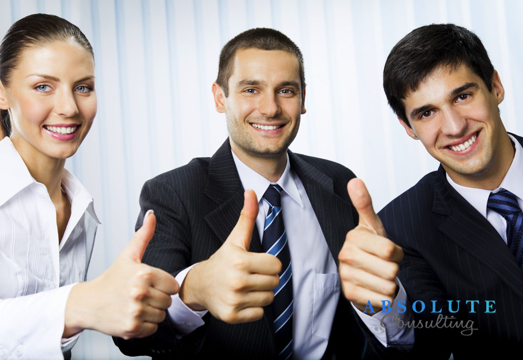 Happy successful gesturing businesspeople at office