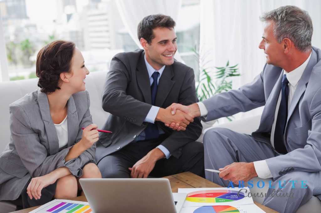 Cheerful business people agreeing on contract in cosy meeting room